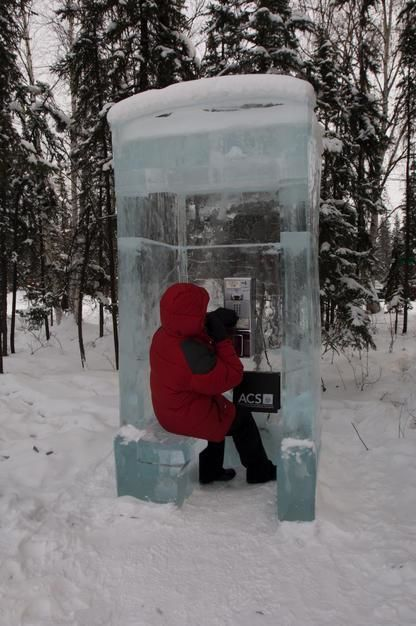 A woman in a telephone booth made of ice in Fiarbanks Ice Museum, Alaska. USA. [Dagens foto - september 2011]