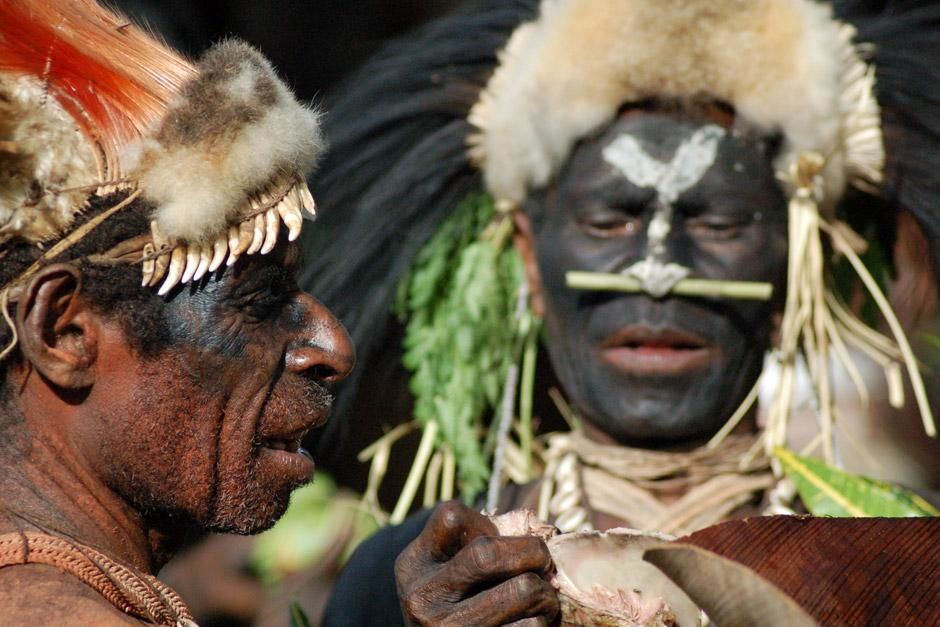 Papua New Guinea, Western Province: Two members of The Biami tribe in Negadai village prepare for... [   -  I  2012]