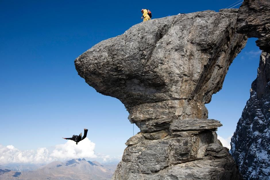 Profile of Mushroom Rock as Joby jumps, Jimmy Pouchert standing above. This image is from Adventu... [Photo of the day - August, 2012]