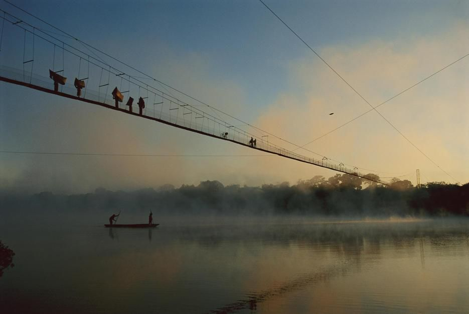 Twighlight view of a 700-foot-long cable bridge, designed by a local priest, that spans the Zambe... [Photo of the day - September 2011]