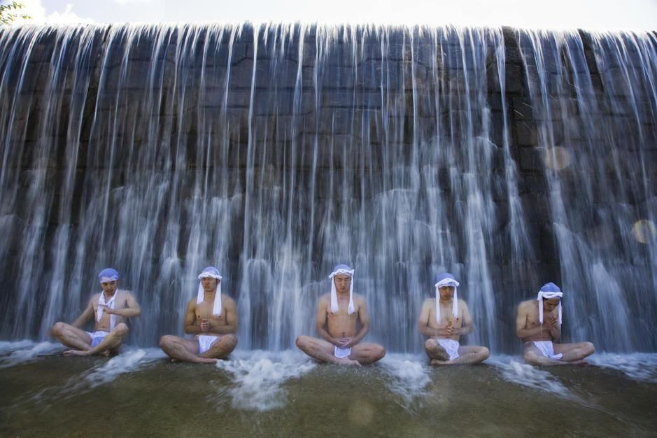 Men sit under a waterfall as part of training to become a Yamabushi, Mt. Haguru, Yamagata Prefect... [Dagens foto - september 2011]