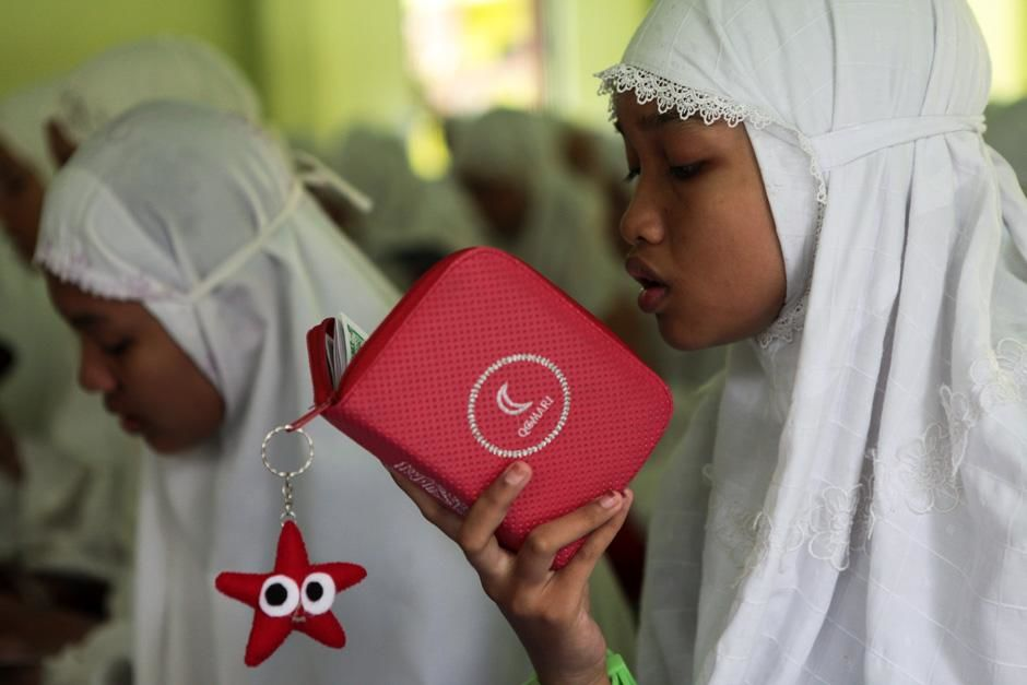 Ponorogo, East Java, Indonesia: A student studying the Koran  at the Al Mawaddah Women's Islamic ... [Photo of the day - September, 2012]