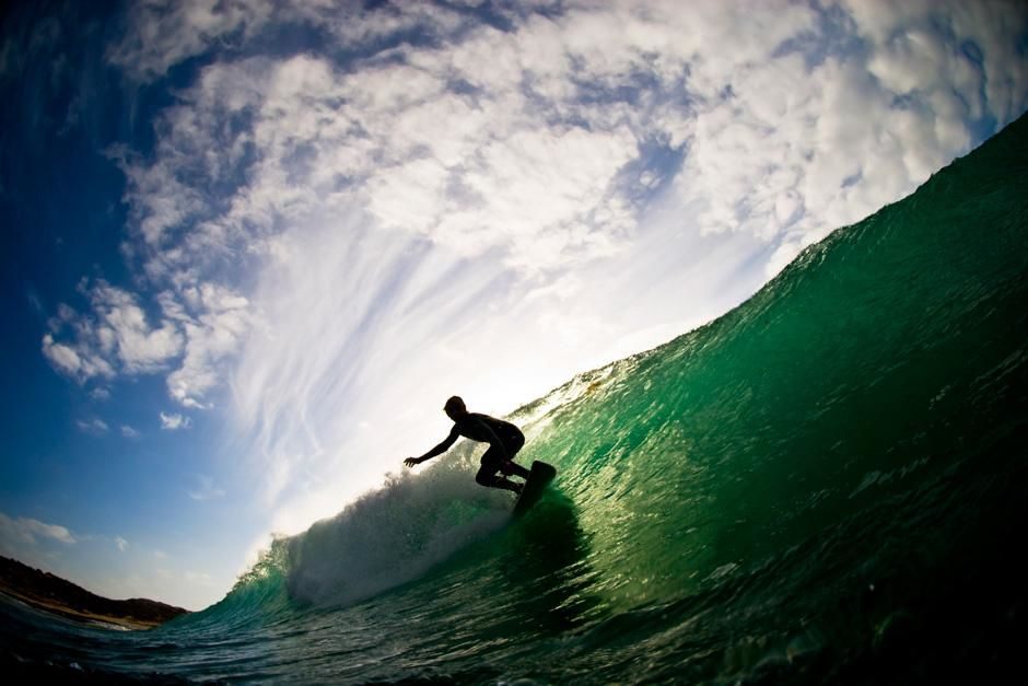 Surfer Silhouette with light shining through a wave. This image is from Destination Extreme. [Photo of the day - 十月 2012]