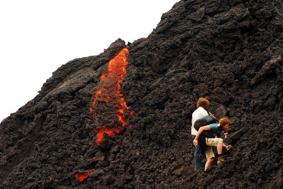 Pacaya Volcano, Guatemala: Two people come very close to lava on the Pacaya Volcano in Guatemala,... [Photo of the day - October 2012]