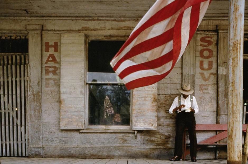 A man eating on the front porch of an old store in Lorman, Mississippi. USA. [Photo of the day - July, 2011]