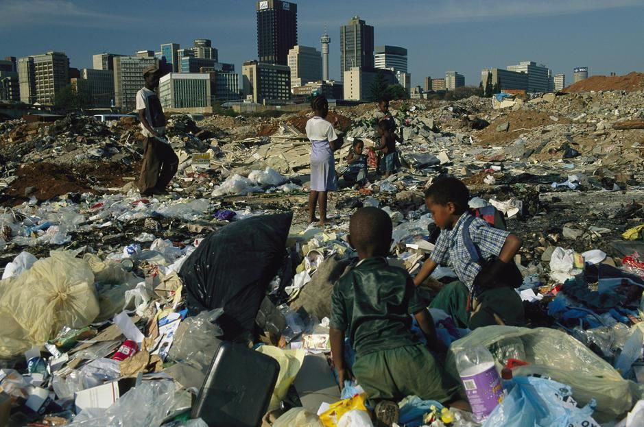 Children scavenging in a dump on the outskirts of Johannesburg. South Africa. [Photo of the day - October, 2011]