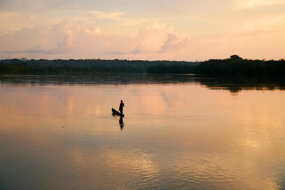 Central African Republic: A lone man on his boat sits in calm waters. This image is from My Goril... [Photo of the day - December 2012]