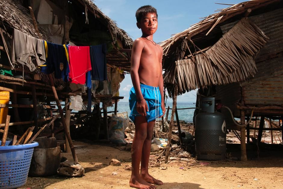 Phi Phi Island, Thailand: A young boy standing. This image is from Laya Project. [Photo of the day - آوریل 2013]