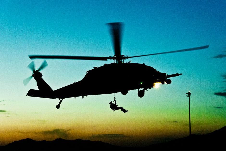 Kandahar Airfield, Afghanistan: A PJ hoists down from a HH-60G Pave Hawk helicopter at dusk.... [Photo of the day - June 2013]