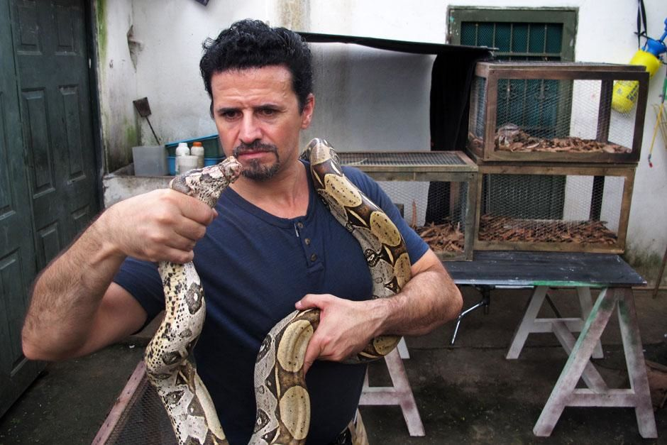 Belize: Reenactment. Tom with a snake aroud his neck. This image is from Banged Up Abroad. [Photo of the day - July 2013]
