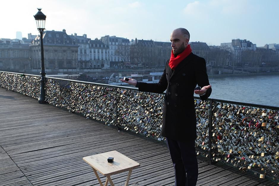 France: Drummond Money-Coutts on Pont Des Arts with ring boxes. This image is from Card Shark. [Photo of the day - September 2013]