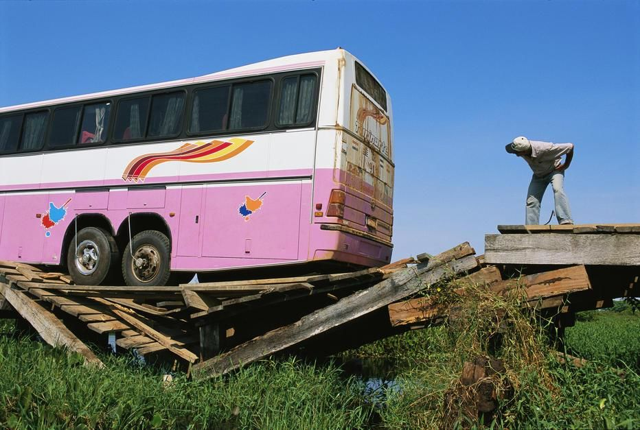 A tourist bus packed with people splinters a wooden bridge on the Transpantaneira Highway, Pantan... [Photo of the day - december 2011]