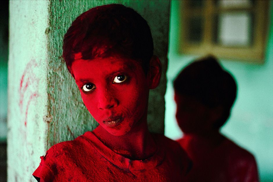 Mumbai, India: An Indian boy is dusted with red powder during Ganesh Chaturthi.  This image is... [Photo of the day - اکتوبر 2013]