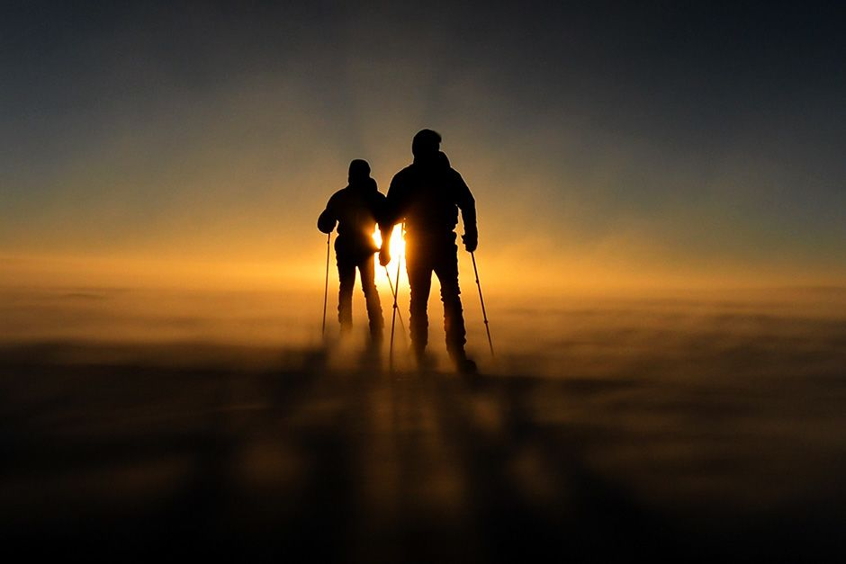 Queen Maud Land, Antarctica: Two members of the team ski through the Antarctica dusk. In the... [Photo of the day - اکتوبر 2013]