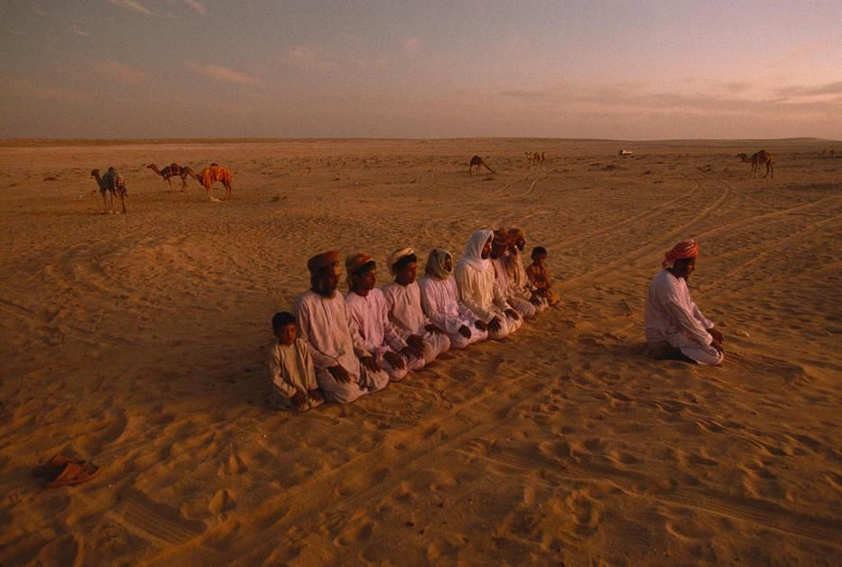 Evening prayer at the camp of the Hamad Haraiz Harsousi Bedouins, Jiddat al Harasis. Oman. [Photo of the day - December 2011]