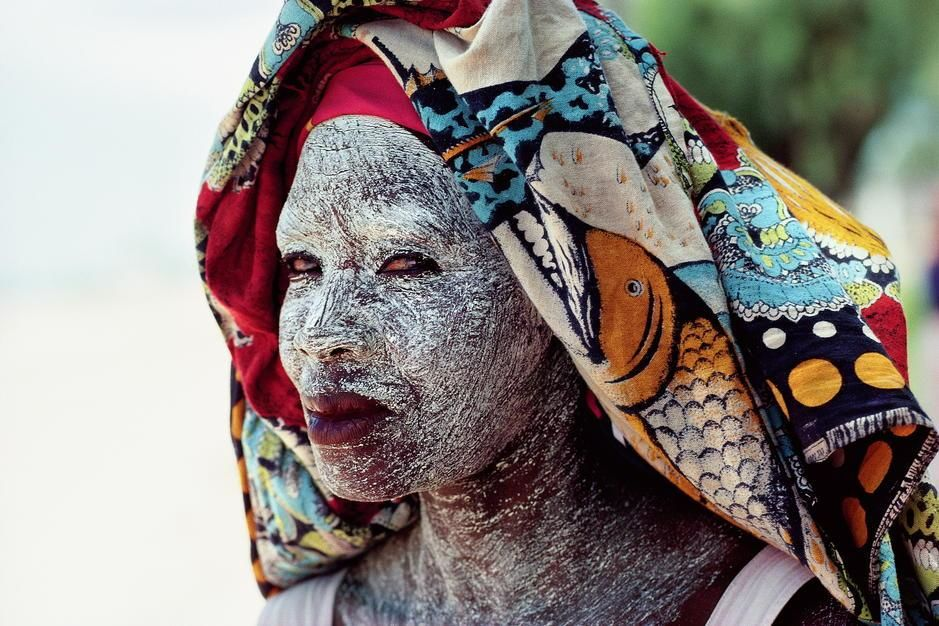 An African woman protects her face from the equitorial sun with cream made from ground bark in th... [Photo of the day - december 2011]