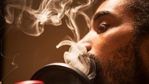 Miami, Floria, USA: Close up of Dreadeyez smoking weed. This image is from Drugs, Inc. Photo of the day -  5 december 2013
