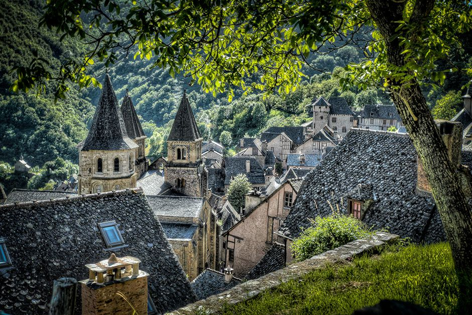 France: The Village of Conques, France taken through some trees. This image is from The Quest for... [Photo of the day - December, 2013]