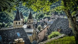 France: The Village of Conques, France taken through some trees. This image is from The Quest for... Photo of the day -  7 December 2013