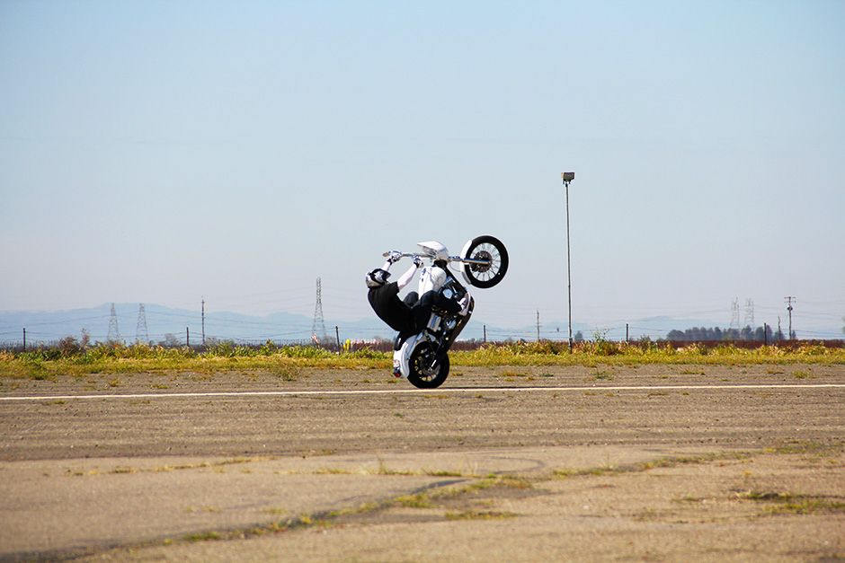 Kingdon Airport, Lodi, California, USA: Joe Padilla popping a wheelie on a Dyna motorcycle. This... [Photo of the day - December 2013]
