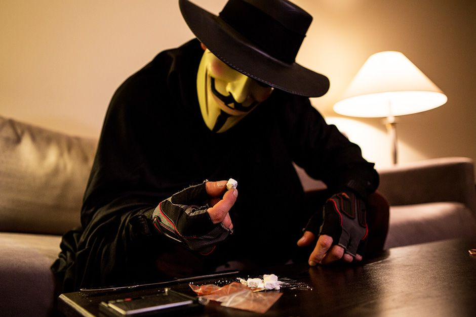 Miami, Florida, USA: South beach cocaine dealer in a mask inspecting his stash. This image is... [Photo of the day - December 2013]