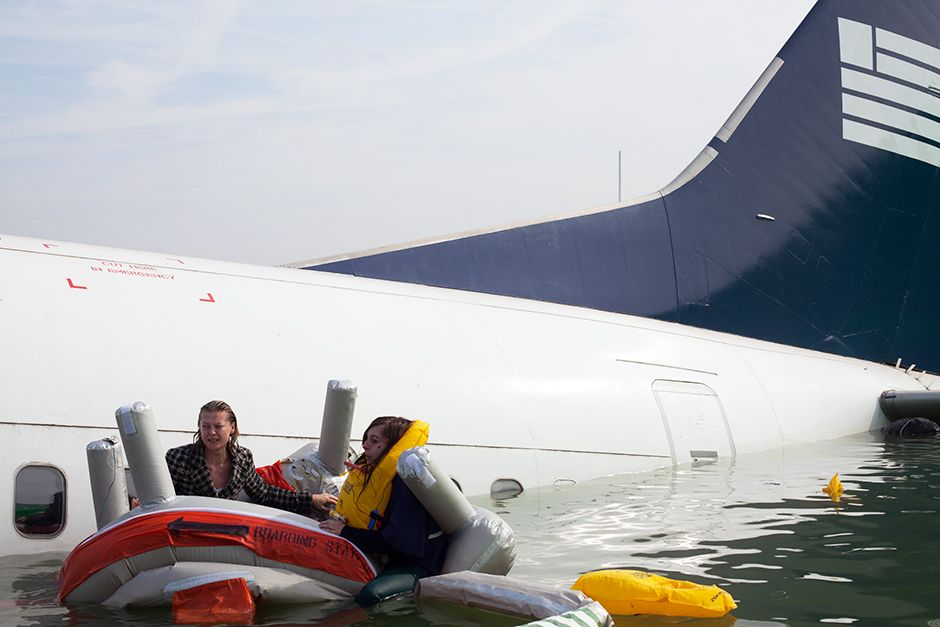 REENACTMENT: Passengers try to stay afloat after the plane crashes in the water. This image is... [Photo of the day - January 2014]