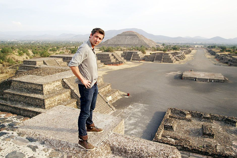 Mexico City, Mexico: Conor Woodman at the top of the Moon Pyramid investigating the artefact... [Photo of the day - January 2014]