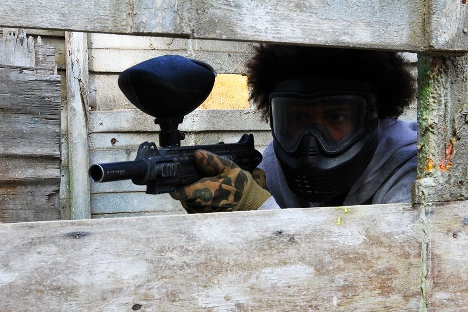 Los Angeles, California, USA: A paintball participant takes cover and hides as he tries to... [Photo of the day - February 2014]