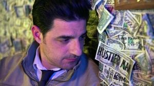 Oatman, Arizona, USA: Alexis Conran in the dollar bill bar where he made a bet involving guessing... Photo of the day -  8 March 2014