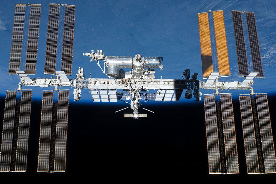 Space Station, May 29, 2011: Back dropped by Earth's horizon and the blackness of space, the... [Photo of the day - March 2014]