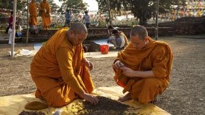 In Lumbini, Nepal, the birthplace of The Buddha. Thai monks examine dirt from the archaeology dig... Photo of the day - April 23, 2014