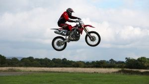 Dunsfold, Guildford, Surrey, UK: A motorbike professional performing a jump. This image is from S... Photo of the day - April 24, 2014