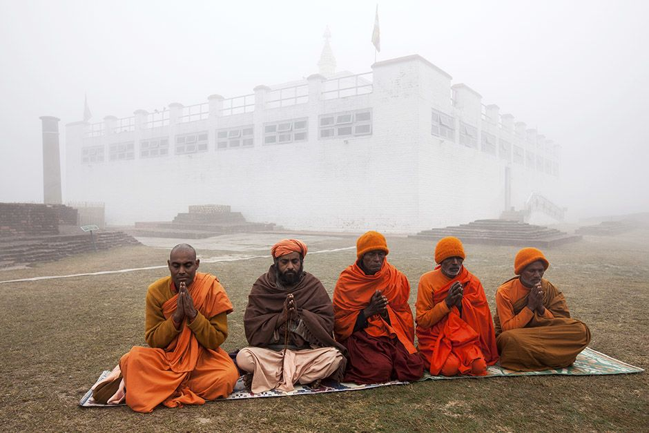 In Lumbini, Nepal, the birthplace of The Buddha. Pilgrims pray by the Asokan Pillar on a foggy... [Photo of the day - April 2014]