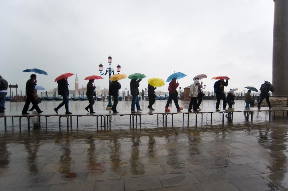 Pedestrians on an elevated walkway at high tide in Piazza San Marco, Venice. [Photo of the day - מרץ 2011]