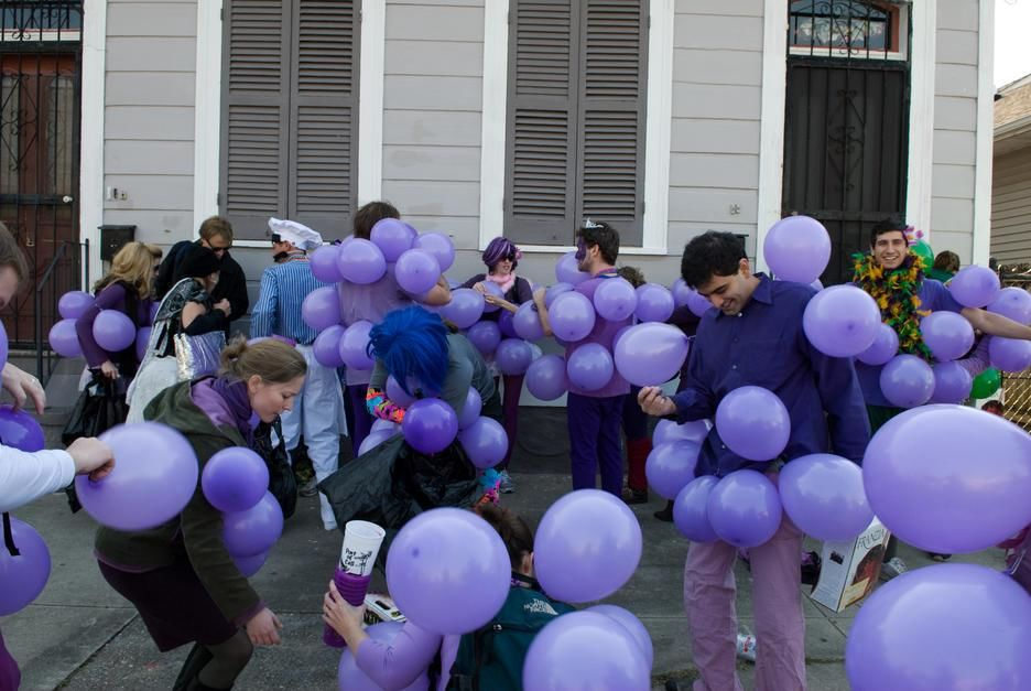 People parade, dressed as grapes and carrying boxes of wine to serve to spectators in New Orleans... [  -  2011]