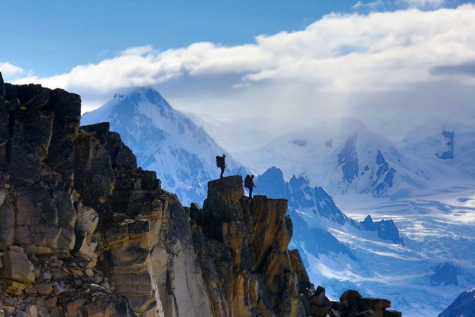 Tordrillo Range, Alaska, USA: A team waiting atop a mountain peak. This image is from Ultimate Su... [Photo of the day - August 2014]