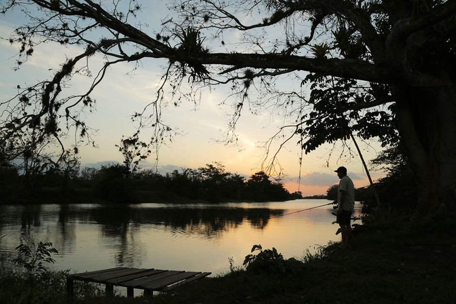 San Juan River, Nicaragua, Central America: Zeb Hogan fishes from the river bank as night falls o... [Photo of the day - August 2014]
