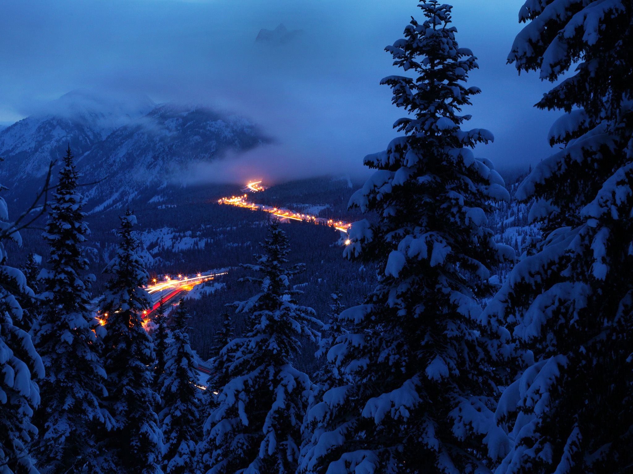 Snow-filled mountain, trees, and highway from lookout point. This image is from Highway Thru Hell. [Photo of the day - اکتوبر 2014]