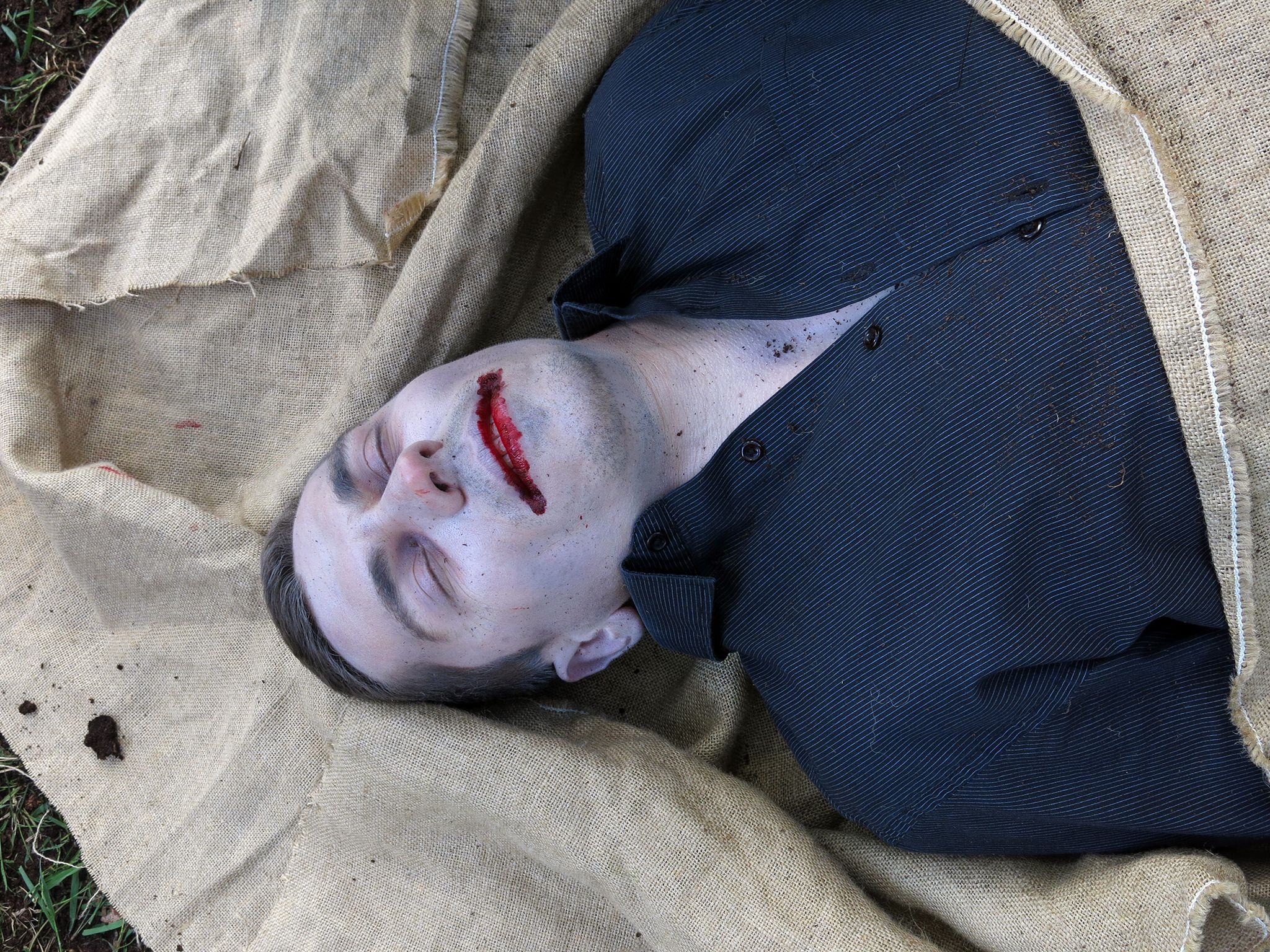 Drama Reconstruction: The exhumed body during the ritual of putting to rest a strigoi. 