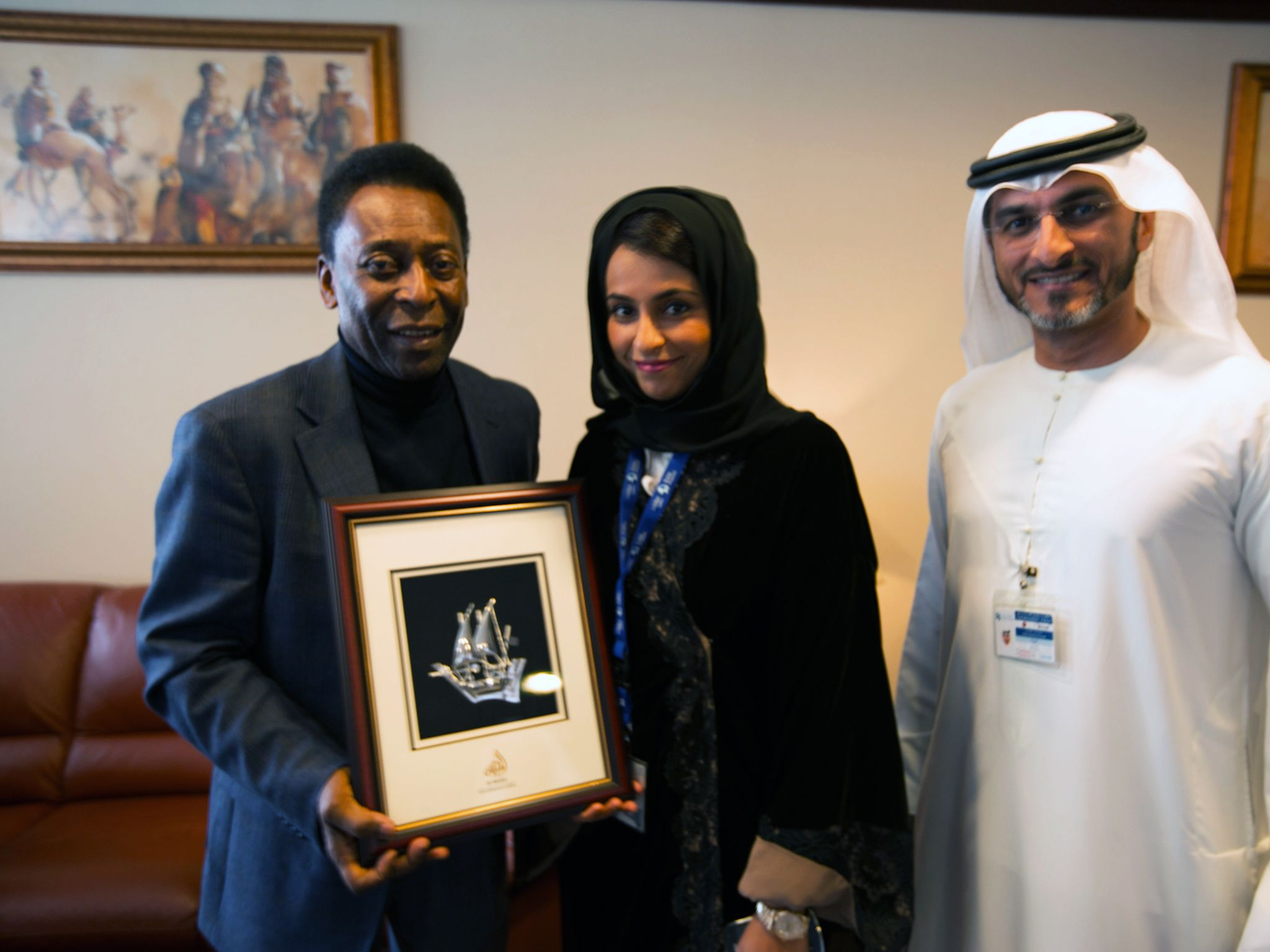 Dubai Airport, UAE: Pele poses for photos with Najla Al Midfa and Rabee Al Awadi. This image is f... [Photo of the day - دسامبر 2014]