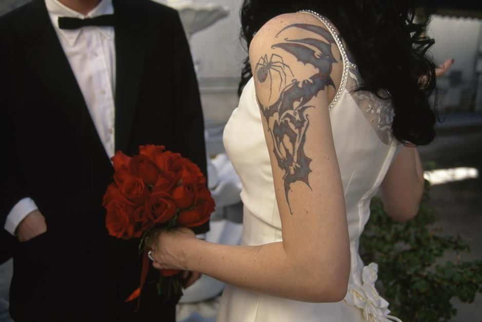 A tattoed bride and her groom, Little White Chapel, Las Vegas. [  -  2011]