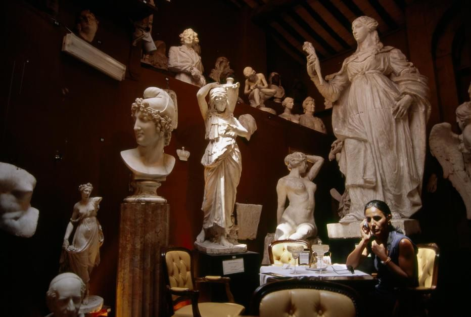 A woman talking on a cellphone in Canova Tadolini Restaurant, Rome. [  -  2011]
