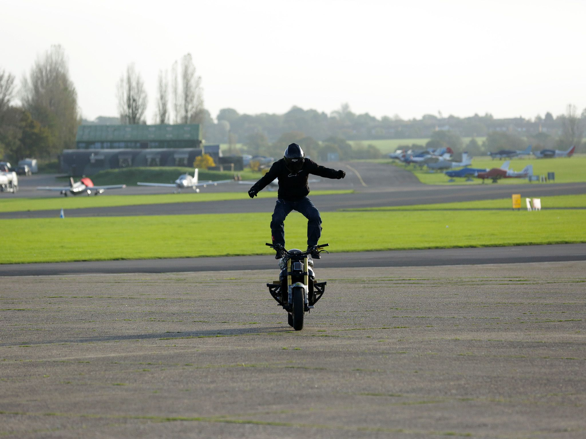 Essex, England: Mark Van Driel performing the stunt Moto Surfing where a rider stands on a moving... [Photo of the day - February 2015]