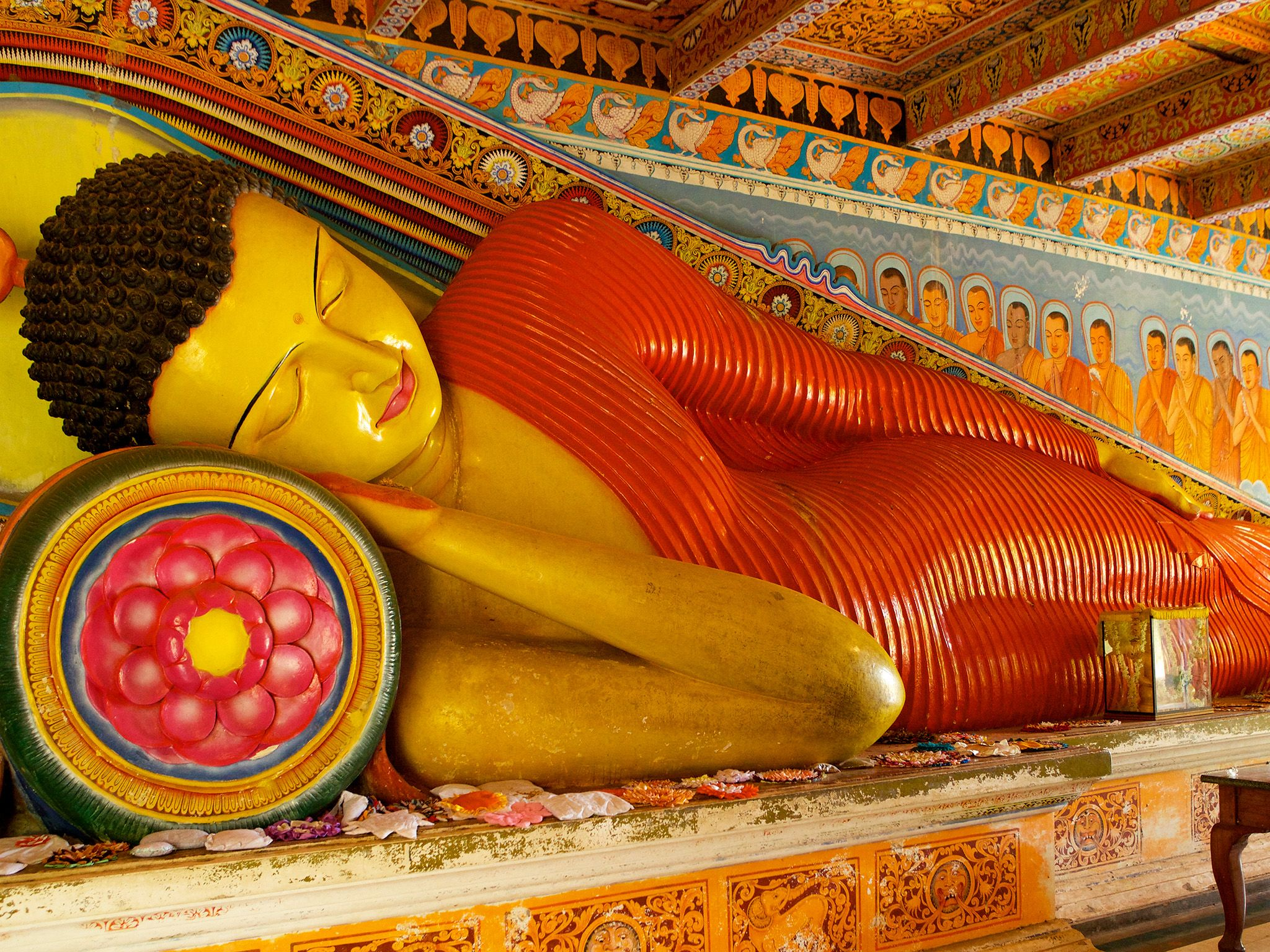 Sri Lanka A reclining Buddha in the colourfully decorated Isurumuniya Rock Temple at Anuradhapura... [Photo of the day - مارس 2015]