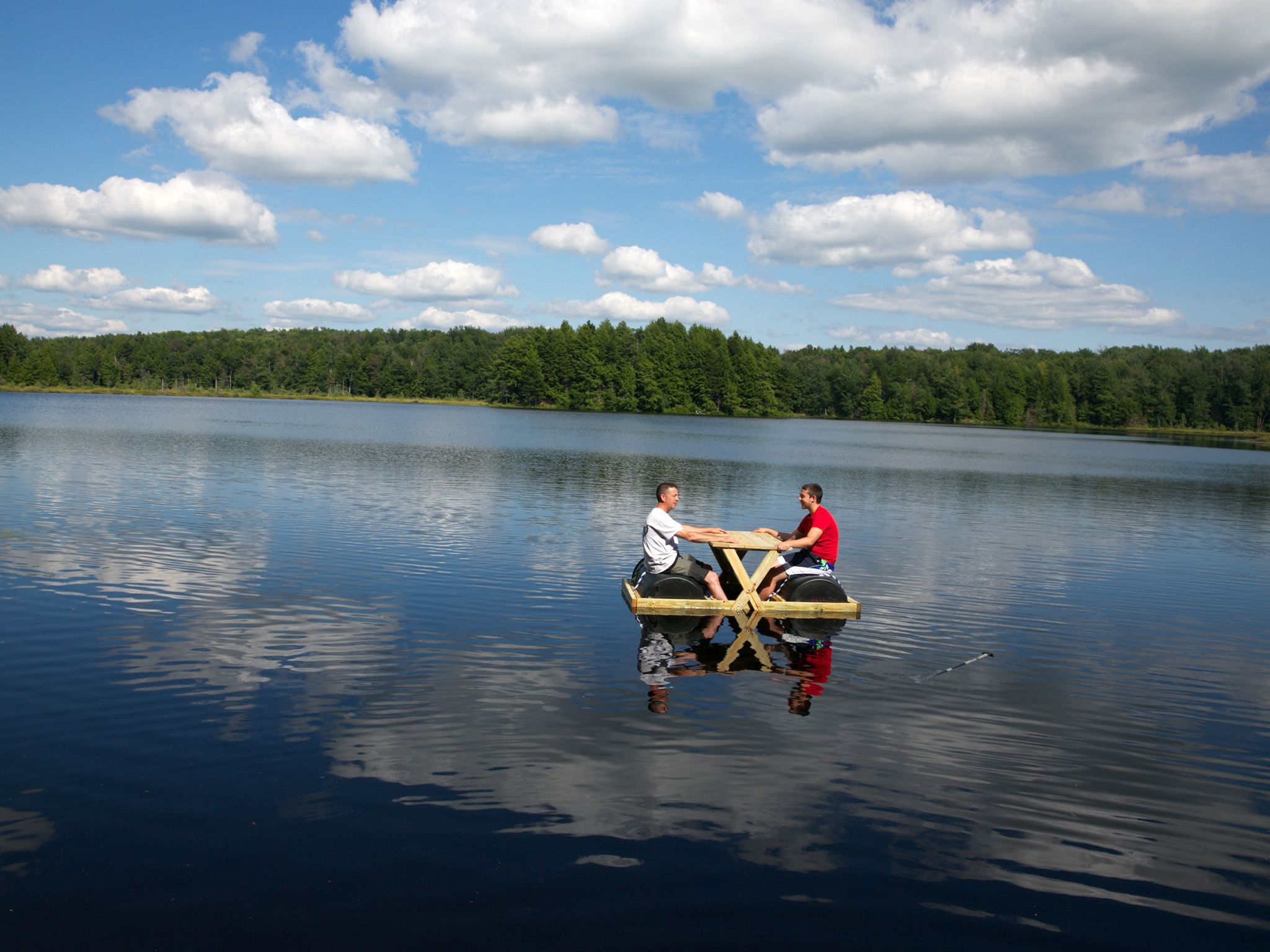 Bennington, VT: Tom Kiely and his son sit on a floating park bench on the lake. This image is... [Photo of the day - می 2015]