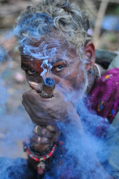 A sandhu smokes at a small temple in Vishakhapatnam. [صورة اليوم  - می 2011]