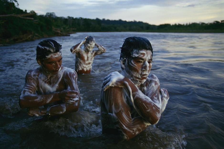 A group of Tacana guides bathe at the day ends in the Tuichi River. Bolivia. [Photo of the day - August, 2011]