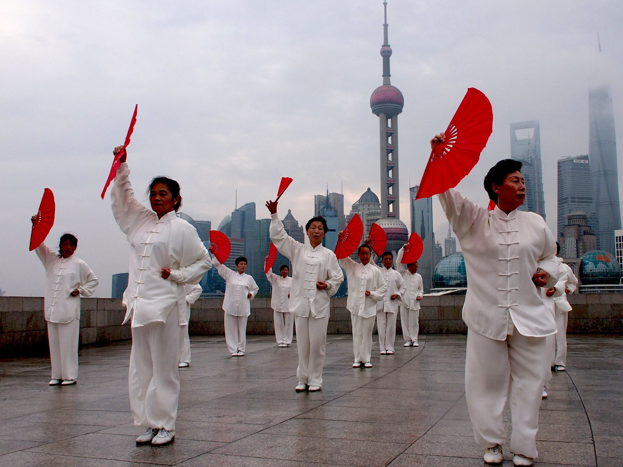 Shanghai: Taiji practitioners by the Bund. This image is from China From Above. [Photo of the day - July 2015]