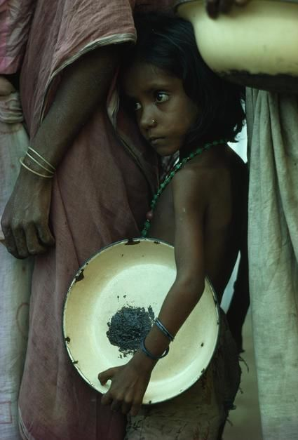 A girl waits for relief food. [  -  2011]