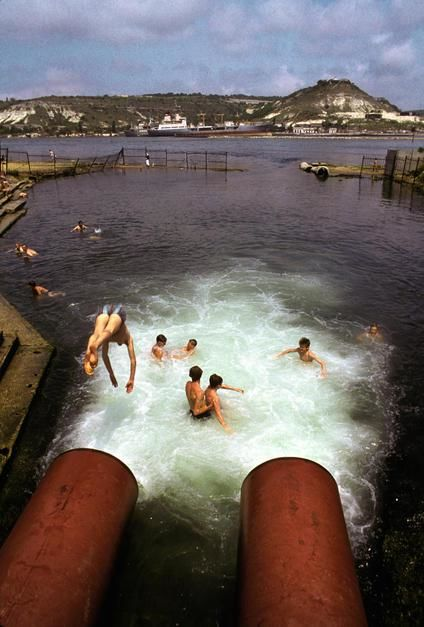 People swim in the Sevastopol Thermal and Electrical Power Plant, once the main plant of the Crimea. [תמונת היום - יוני 2011]